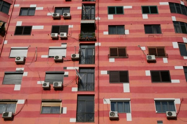 The mayor of Tirana at the time Edi Rama, an artist himself, painted the facades in bright colors